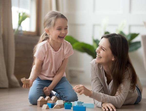 Mother and daughter playing with block shapes